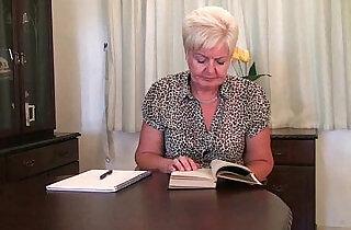 Highly sexed grandma Sandie rubs her pierced clit.  xxx porn