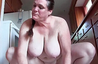 Granny with big tits cleaning the kitchen naked.  xxx porn