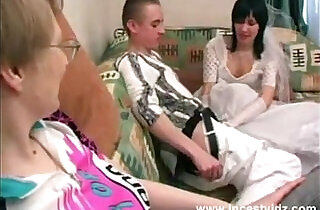 Mother, son and horny daughter in wedding dress in action.  xxx porn