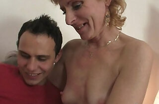 Blonde granny jumps on young cock.  xxx porn