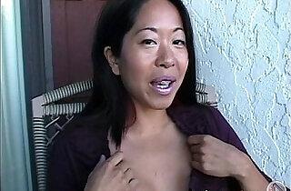 Asian Mame flashing boobs on a balcony in Canada.  xxx porn