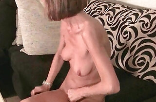 Skinny grandma massages her small tits and rubs her tight white pussy.  xxx porn