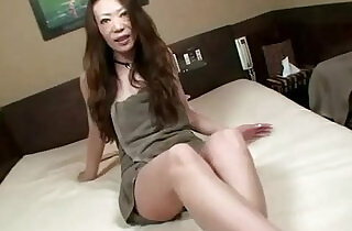 Asian milf uses vibrator and loves it.  xxx porn