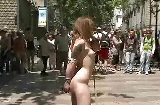 Brunette in outdoor public humiliation.  public place   xxx porn