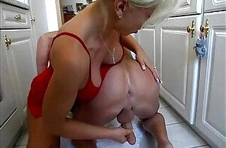 Dominatrix sexy amateur milf having fun in the kitchen.  xxx porn