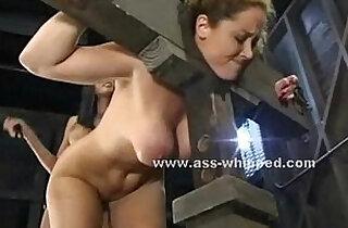 Brunette slaps and floggs her slave.  xxx porn