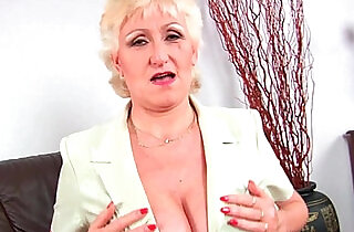 Granny with her big tits finger fucks her sweet pussy.  xxx porn