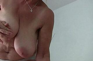 Granny with tits masturbates in pantyhose.  xxx porn