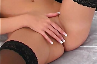 Pretty blonde cutie teases in lingerie and stockings.  xxx porn