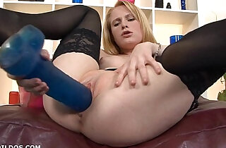 Strawberry blonde fucked by two big brutal dildos.  xxx porn